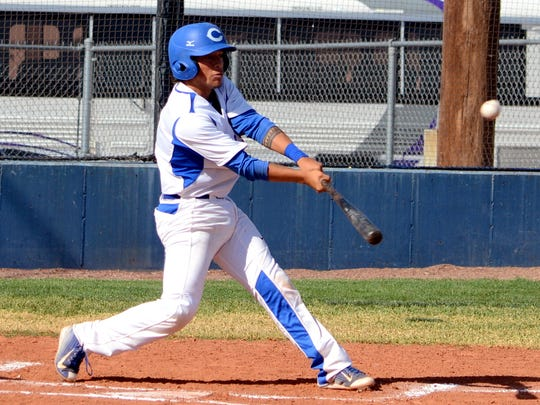 Carlsbad's Seth Olguin makes contact at the plate in game one Friday against Clovis.