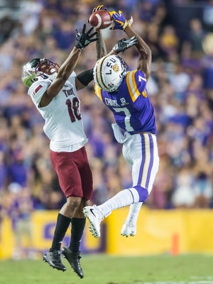 Tigers wide receiver D.J. Chark (7) with the near catch as the LSU Tigers take on the Troy Trojans in a non-conference contest on Saturday Sept. 30, 2017 in Death Valley.