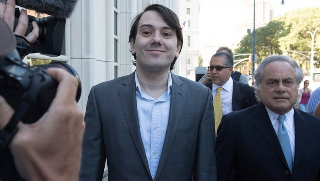 Photo taken 6/26/17 shows Martin Shkreli, center, and defense lawyer Benjamin Brafman entering Brooklyn federal court in New York City for jury selection in Shkreli's conspiracy and securities fraud trial.