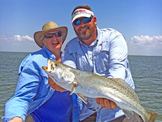 Lauren White caught this big speckled trout while fishing in the Baffin Bay area. That's John Little holding the fish.