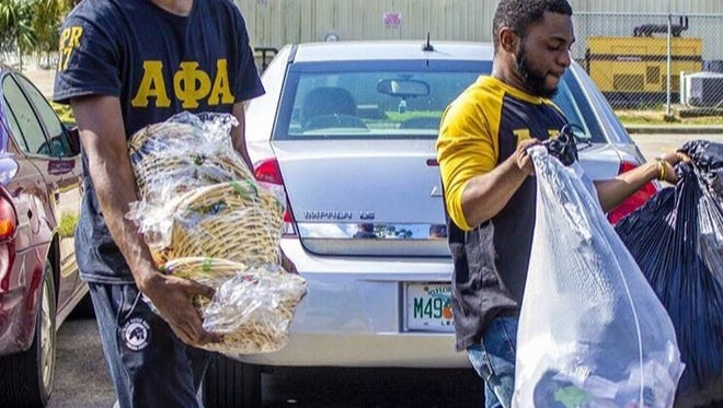 Sharard Shabazz, left and Moses Lordeus, right, making a previous delivery to the Kearney Center.