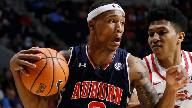 Auburn guard Bryce Brown (2) battles with Mississippi guard Breein Tyree (4) as he tries a layup during the second half of the NCAA college basketball game in Oxford, Miss., Tuesday, Jan. 30, 2018. Auburn won 79-70.