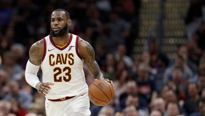 Cleveland Cavaliers' LeBron James drives against the Toronto Raptors in the first half of an NBA basketball game, Tuesday, April 3, 2018, in Cleveland. (AP Photo/Tony Dejak)
