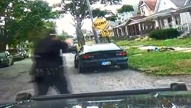 A dashcam video released by an Ohio police department shows two officers fatally shooting an armed man who appeared to be walking away.
