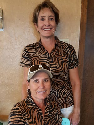 Low Gross Over the Field – Denise Bowers and Theresa Massey (standing).