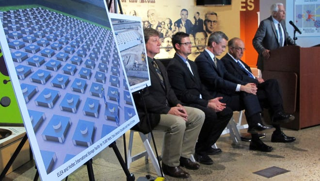 In this April 29, 2015, file photo, an illustration depicts a planned interim storage facility for spent nuclear fuel in southeastern New Mexico as officials announce plans to pursue the project during a news conference at the National Museum of Nuclear Science and History in Albuquerque, N.M. The U.S. Nuclear Regulatory Commission held the first of three public meetings in Roswell, N.M., on April 30, 2018, as it considers the application filed by Holtec International.