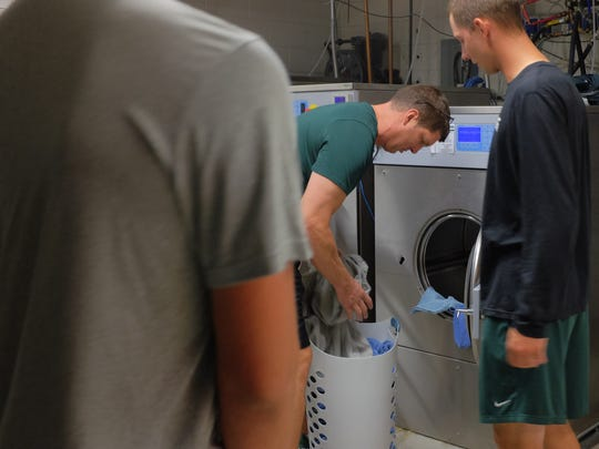 Giant washing machines and dryers get used constantly