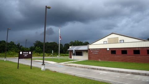 Lamar County supervisors have approved a deal with Lumberton to acquire the city's closed Mississippi Army National Guard armory.