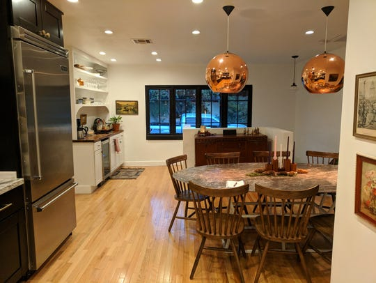 The open floor plan allows for flow through the kitchen