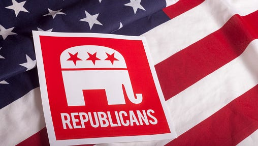 A stock image of a Republican sign on an American flag.