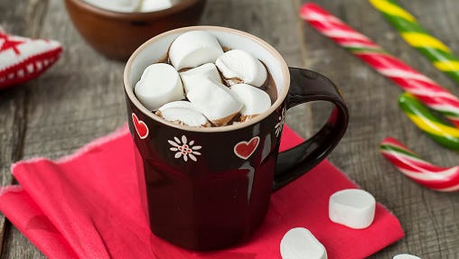 A stock image of marshmallows in hot chocolate.