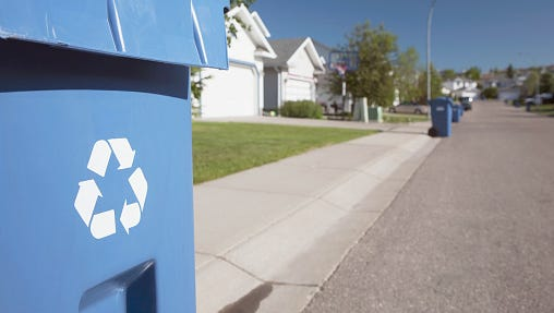 Recycling Bin On The Curb Side Of A Neighborhood