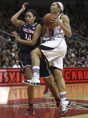 Louisville's Tia Gibbs goes up for a basket against Connecticut on March 3, 2014. The Cardinals and the Huskies will meet for the 18th time Feb. 12.