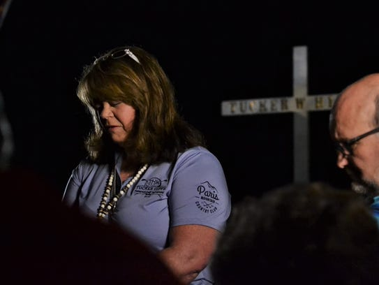 Cindy Hipps leads a prayer for her son, Tucker Hipps,