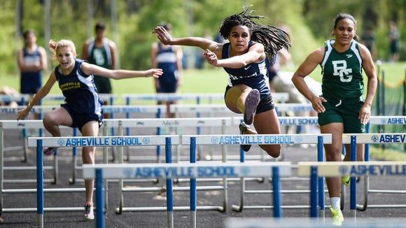 Asheville School senior Gabi Davis has committed to run college track for Emory (Ga.).