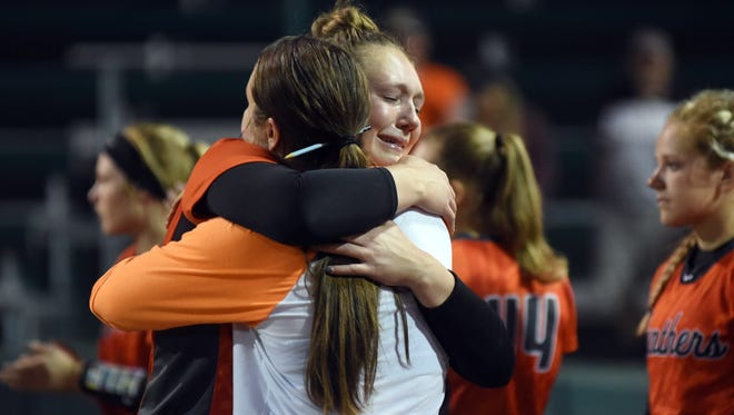 Bailey Harris hugs head coach Alyssa Wolfe following New Lexington's 1-0 loss to Waverly in a Division II district final on Thursday night at Ohio University.