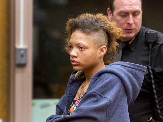 Dominique Warren is arraigned in the Hamilton County Justice Center on Feb. 13  in front of Judge Brad Greenberg. She was picked up the day before for jaywalking on W. McMicken Ave. in Over-The-Rhine. In her purse, police found a crack pipe and a syringe full of heroin.