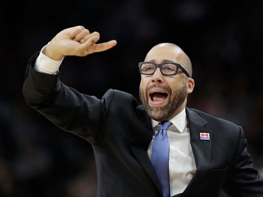 Grizzlies coach David Fizdale signals to his players