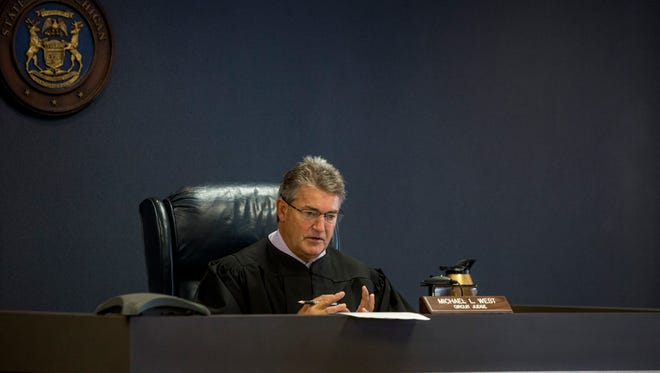 Judge Michael West speaks during sentencing for Douglas Ball Jr. Thursday, June 1, 2017 at the St. Clair County Courthouse in Port Huron. Douglas Ball Jr. was sentenced to life in prison without parole for the murder and torture of his wife, Lydia Ball.