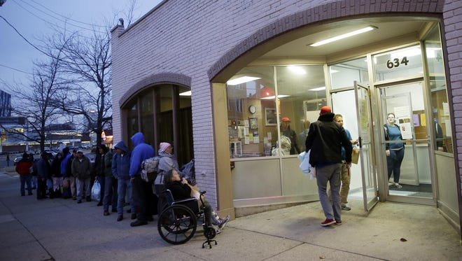 People line up to enter the Emergency Cold Shelter of Northern Kentucky in Covington.