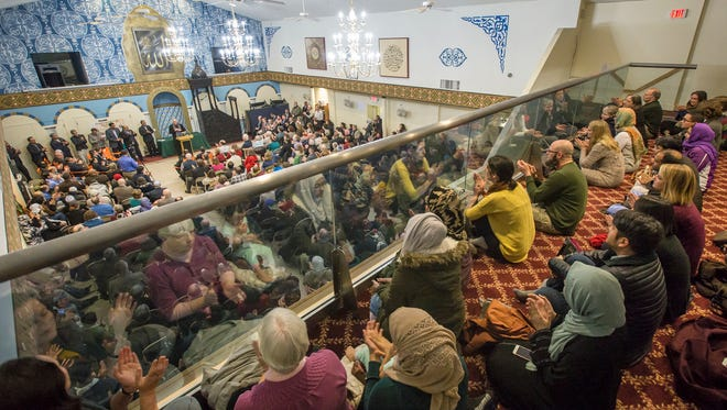 Hundreds of people gather at the Islamic Society of Delaware for an interfaith service on Monday night.