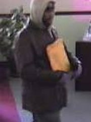 Monroe Township Police say this man, captured on surveillance video, robbed a Newfield National Bank branch March 2.