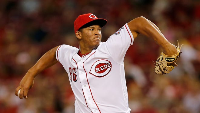 Cincinnati Reds relief pitcher Keury Mella (36) delivers a pitch in the top of the fifth inning of the game between the Cincinnati Reds and the St. Louis Cardinals at Great American Ball Park on Sept. 20, 2017.