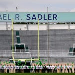 Friends, family and fellow Spartans take the field at Spartan Stadium during a memorial service for punter Mike Sadler, who died in a crash in Wisconsin last week. The  service is under way at Spartan Stadium.