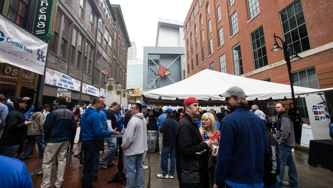 The afternoon rains couldn't keep the O'Shea's UK Pep Rally from happening. The Main Street location of the popular pub had an area in the rear on Washington Street closed off for fans coming and going from the YUM! Center on Thursday. 3/19/15