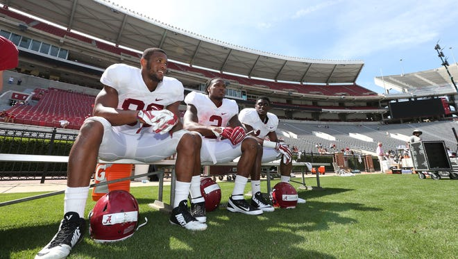 Sitting beside running back Derrick Henry (2) and defensive back Deionte Thomson (14), Alabama tight end O.J. Howard caught two touchdowns in Saturday's scrimmage.