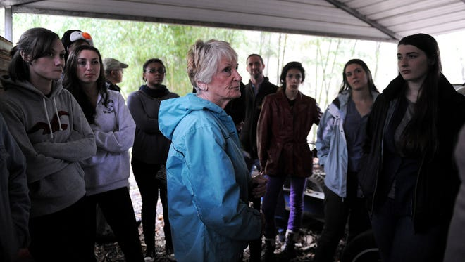Homeowner Dot Rice, center, hosted students in UNCA's environmental studies program at her family's property near the former CTS manufacturing plant off Mills Gap Road in south Asheville.