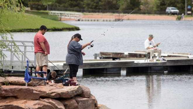 Kathy Owen fishes with her son, Daniel Flores, and grandson, D.J. Flores, at Green Valley Park in Payson.