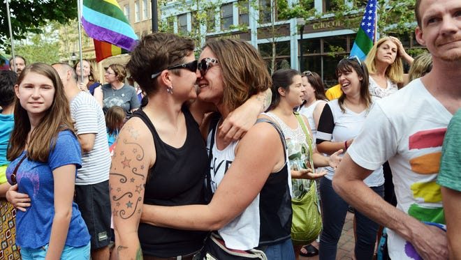 Asheville residents Robyn Moser, left, embraces her partner Kathleen McCafferty as hundreds gathered at Pack Square Park during a rally celebrating Friday's decision by the United States Supreme Court, which determined same-sex couples in America could be married in all 50 states.