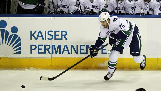 In this file photo, Defenseman Bobby Sanguinetti played all season with the Utica Comets last season but did play in the NHL preseason with the Vancouver Canucks.