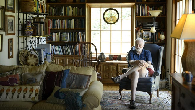 Dr. James Turpin sits in the living room of his home in Fairview, which is filled with memorabilia, such as baskets, pottery and pillows, from his travels around the world working with the organization he founded, Project Concern International. Turpin has provided aid to the needy in countries all over the world.