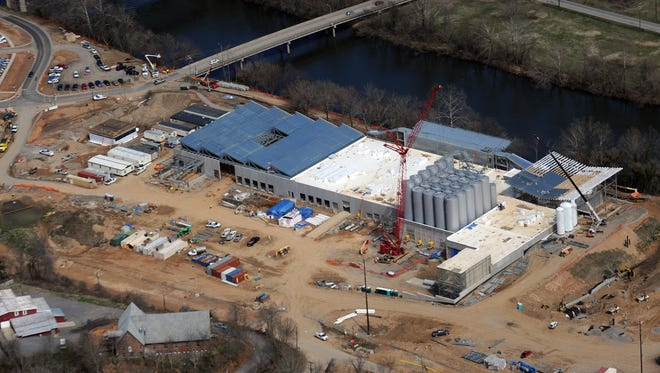 Construction of the New Belgium Brewery as of April on the west bank of the French Broad River in Asheville. The brewer received a $7.5 million incentive and agreed to invest $115 million and create 130 full-time jobs.