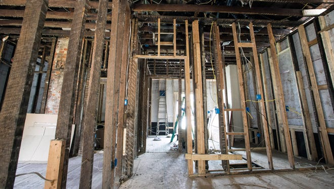 A view down the center hallway to the front of the house shows the skeletal structure of Muhammad Ali's childhood home. The historic landmark on Grand Avenue is being restored with up to code renovations and 1960s interiors. 8/18/15