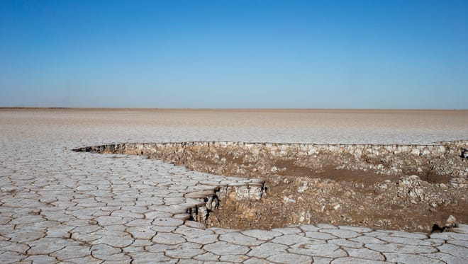 Flats that once teemed with life on a thriving Colorado River estuary now lie disconnected from fresh water at a tidal channel near the boundary of Sonora and Baja California, Mexico, victim of the Southwest's reliance on its largest river.