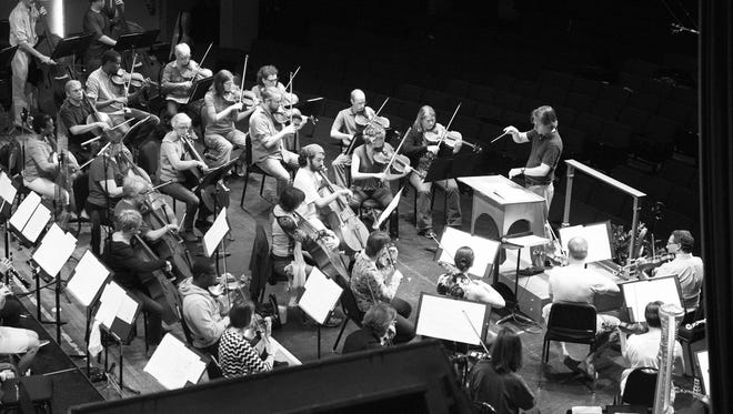 Members of the Asheville Symphony Orchestra perform during a dress rehearsal in September.