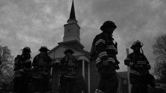 Asheville firefighters work to contain a fire at the Morningside Baptist Church on Mineral Springs Road on Dec. 2.