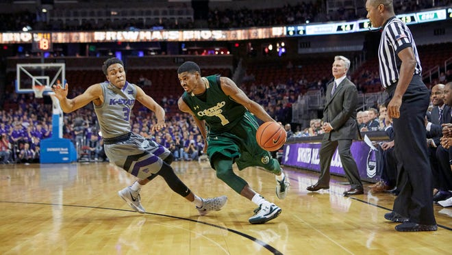 CSU guard Antwan Scott, who took leading scorer Gian Clavell's place in the starting lineup Saturday, drives past Kansas State defender Kamau Stokes during a game in Wichita, Kansas, on Saturday.