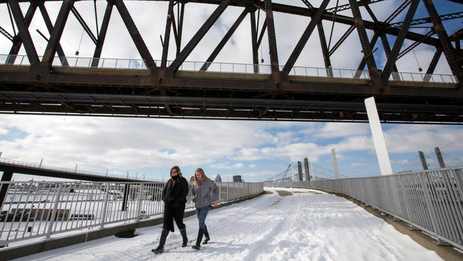 Meghan Husted and Abby Ebersold brave the frigid temperatures to walk the Big Four Bridge on Saturday. 1/23/16