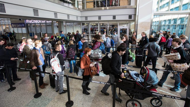 Passengers wait in line to go through the new north security checkpoint of Terminal 1 at the Minneapolis-St. Paul International Airport on Feb. 26, 2016.