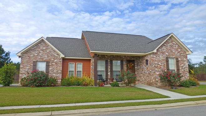 The side-facing garage and prominent front porch create a neighborhood-friendly exterior.