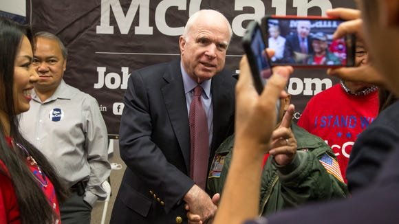 Sen. John McCain, R-Ariz., is photographed with supporters
