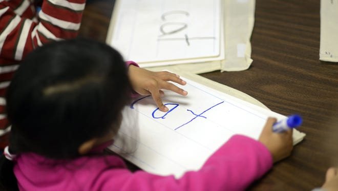 Woodfin Elementary School students work through a reading exercise in this 2015 file photo.