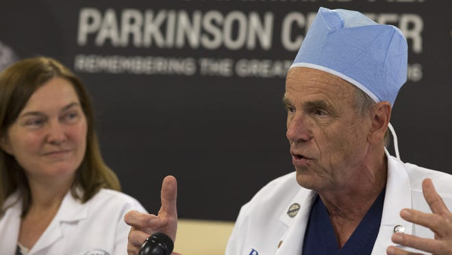 Dr. Robert Spetzler (right), who retired as president and CEO of the Barrow Neurological Institute, home to the Muhammad Ali Parkinson Center, talks during a press conference.