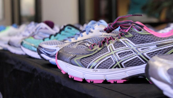 Women's running shoes lined up at the Capital City Runners' booth at the FSU Turnbull Conference Center for Capital Regional Medical Center's Women's Wellness Day on Saturday, July 14, 2012.