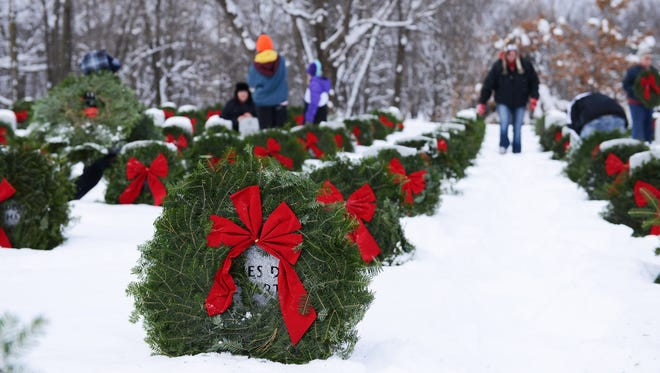 Every December, volunteers place hundreds of wreaths at grave sites in Minnesota State Veterans Cemetery near Little Falls, to honor the country's fallen service members and their famliies