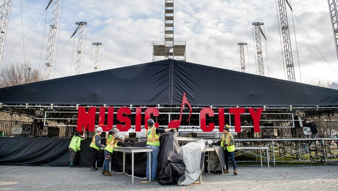 Workers prepare the stage Wednesday, Dec. 28, 2016, for the Jack Daniel's Music City Midnight: New Year's Eve in Nashville event at Bicentennial Capitol Mall State Park.